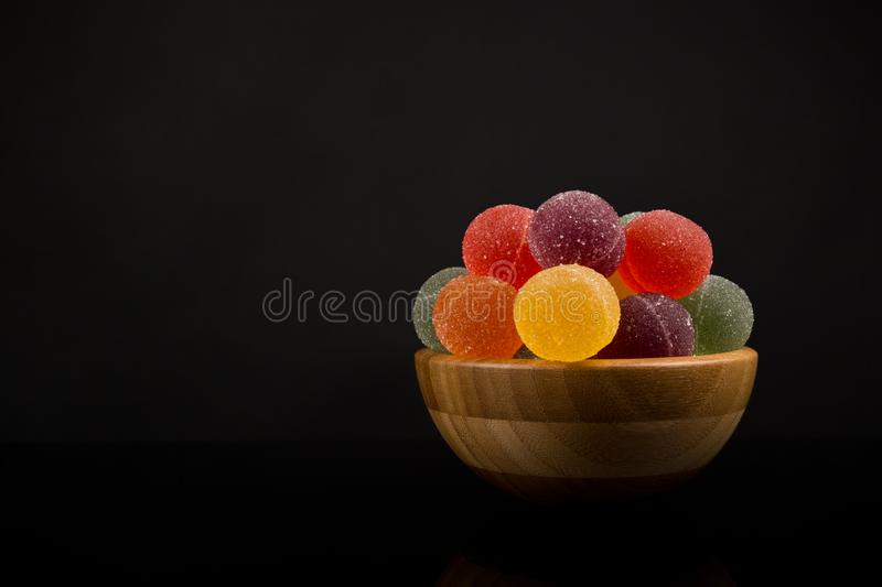 Gumdrops, Colorful Fruit Sugarcoated Marmalade balls in Wooden Bowl. Traditional Scandinavian Christmas Candy royalty free stock image