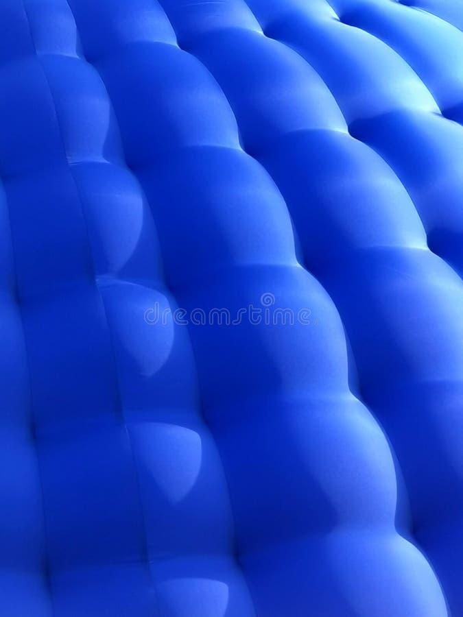 Gummi-blauer Hintergrund stockfotografie