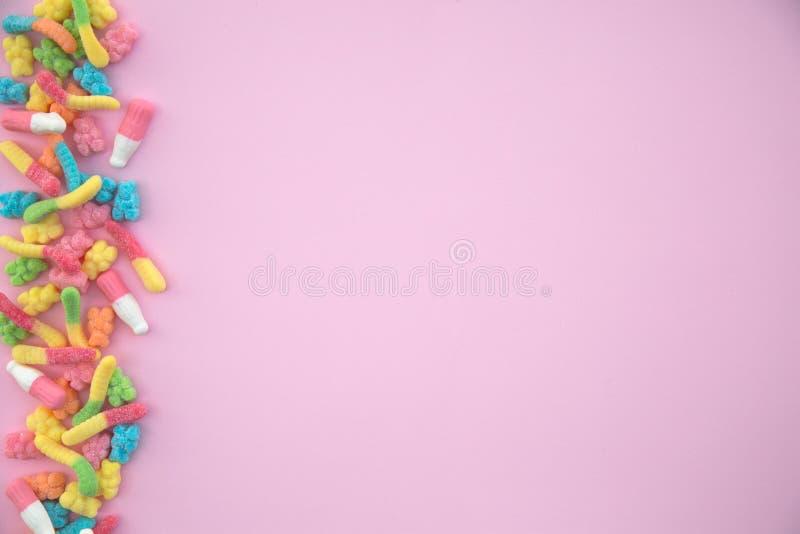 Gummiartig betrifft rosa Hintergrund stockfotografie