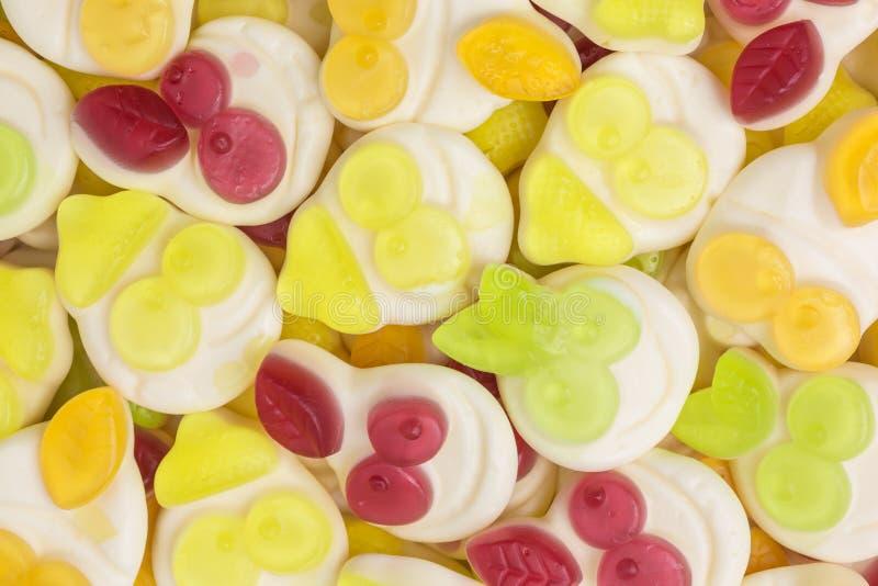 Gummiartiger Süßigkeitshintergrund des Joghurts stockfotos