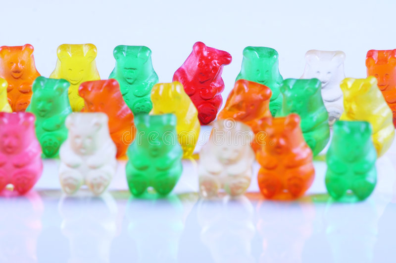 Gummy bears lined up in row