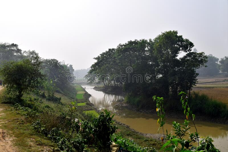The Gumoti River in Bangladesh. South Asian beautiful river in Bangladesh.  Green landscape with small river royalty free stock photo