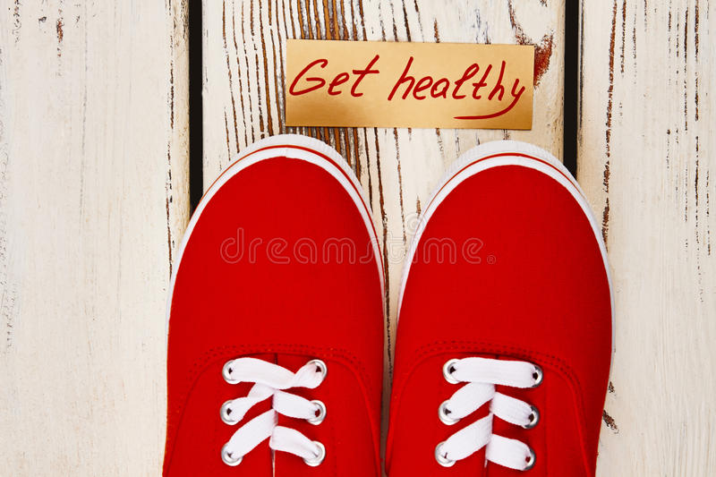 Gumshoes and motivation card. The best walking workouts royalty free stock image