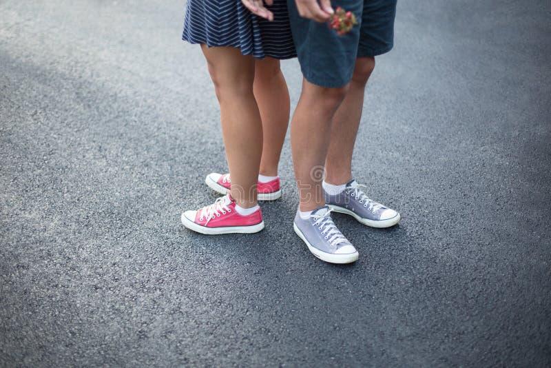 Gumshoes on urban grunge background of asphalt stock image
