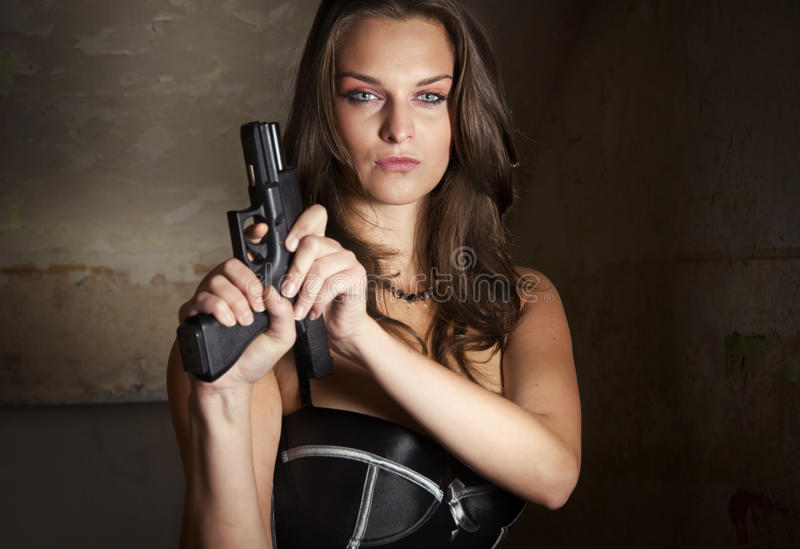 Gun in actions stock images
