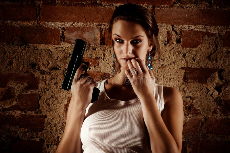 Gun in actions royalty free stock photography