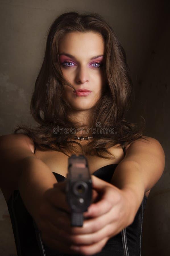 Gun in actions stock photos