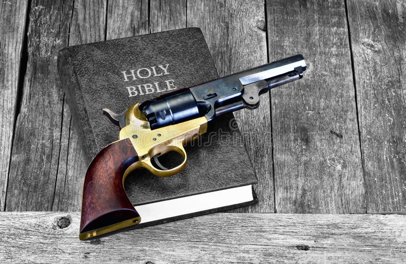 Gun and Bible. Old Western pistol on Holy Bible with room for your type royalty free stock photos