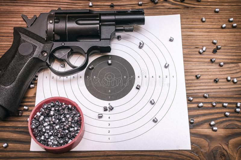 Gun, bullets and target. royalty free stock images