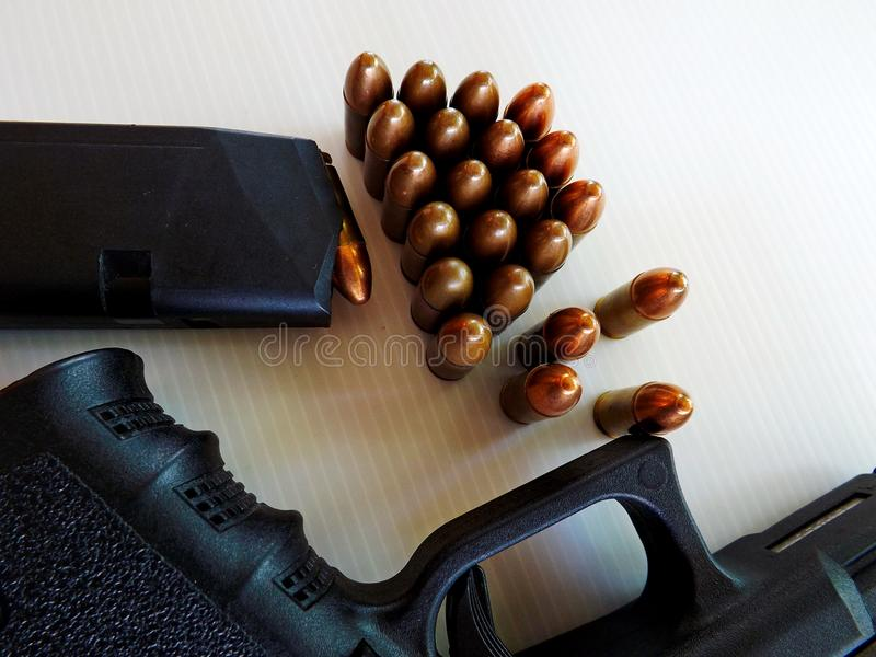 Gun and cartridges. Of 9 mm royalty free stock photos