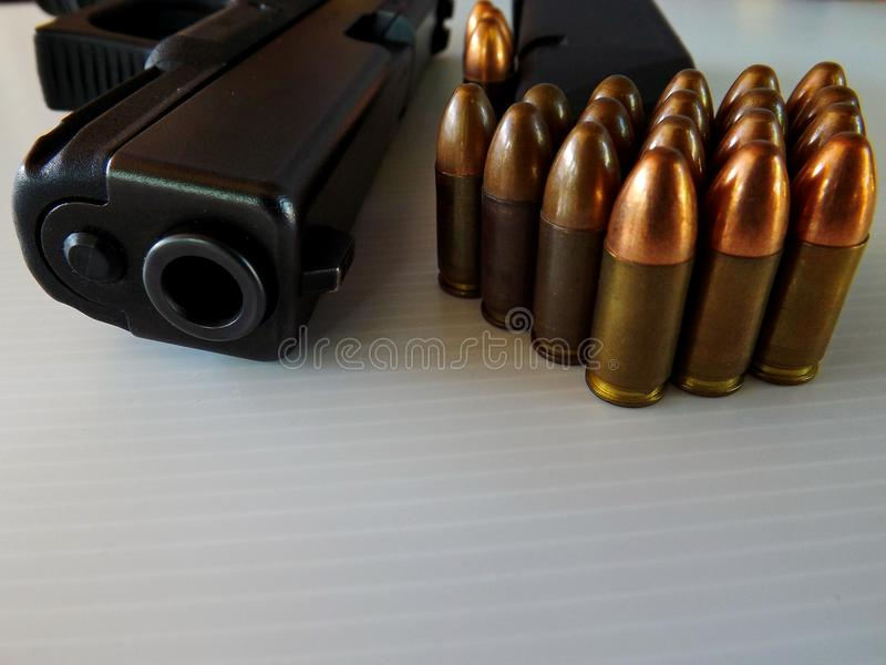 Gun ,Cartridges of 9 mm. On a white background stock photo