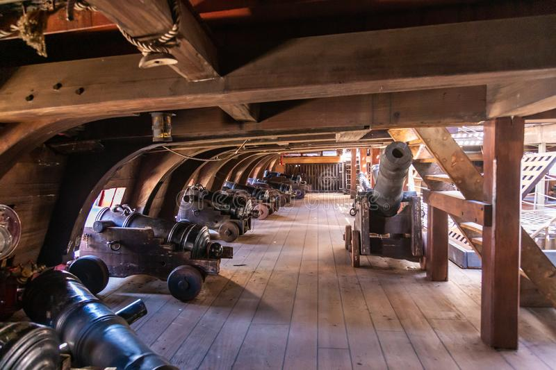On the gun deck of an old pirate ship moored in the port of Genoa, Italy.  stock photography