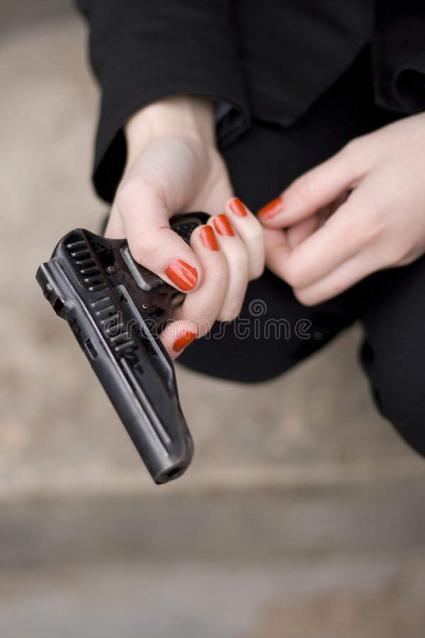 Download Gun in female hands stock photo. Image of criminal, protection - 6415794