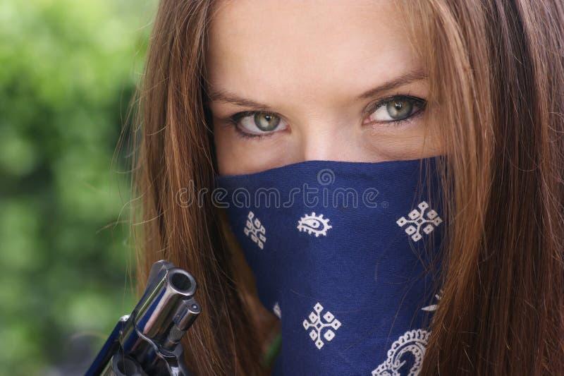 Woman Holding Revolver Snubnose Gun Face Mask royalty free stock image