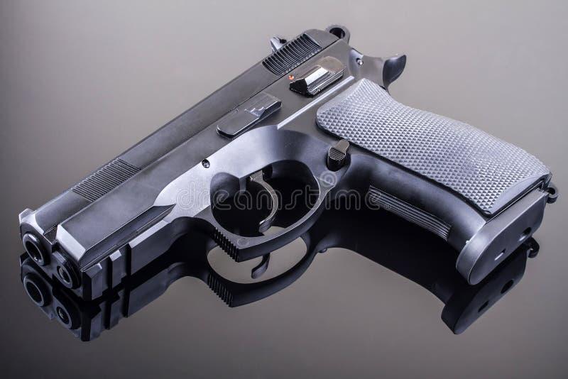Gun on glass table