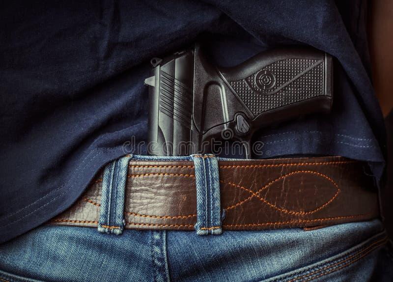 Gun in hand. Hiden gun in the hand stock images