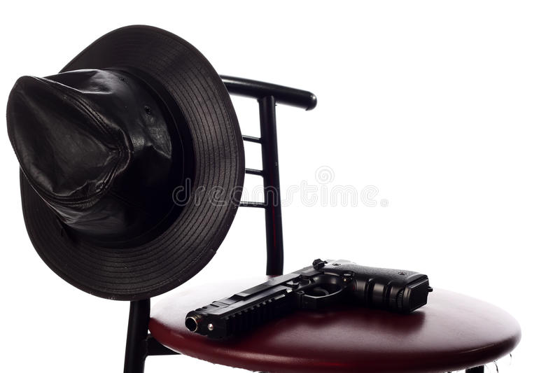 Download Gun and hat on the chair stock photo. Image of security - 12063620