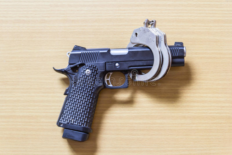 Gun Lock controlled By shackle on wood for Crime prevention stock images