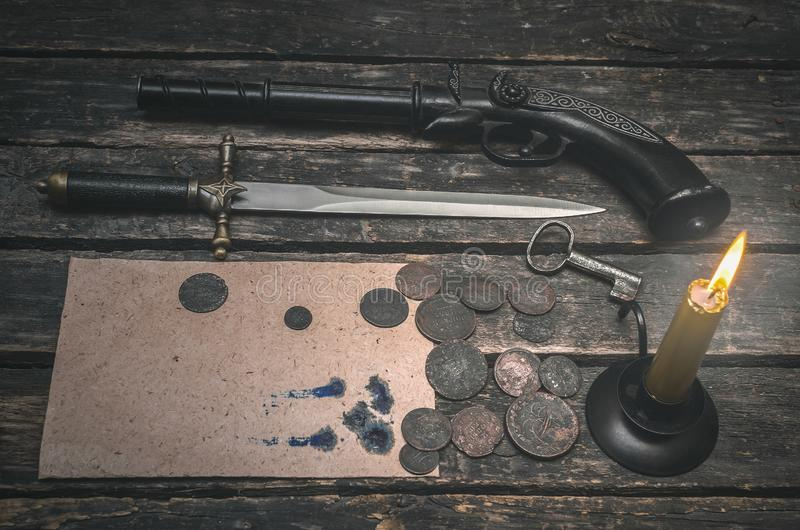 Gun and money. Blank page document, weapon, money and burning candle on the wooden desk table. Compromising evidence royalty free stock photography