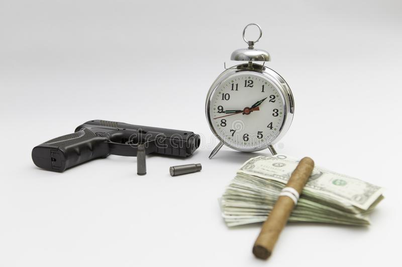 Gun money and clock at the white background stock photos