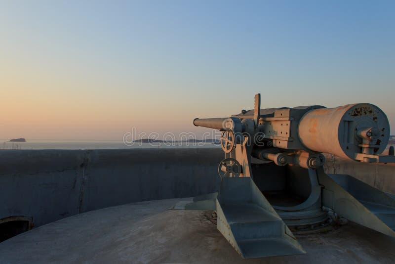 A gun on the Novosiltsevsky battery of the Russian island in Vladivostok. At dawn stock photos