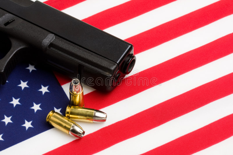 Gun over american flag royalty free stock photo