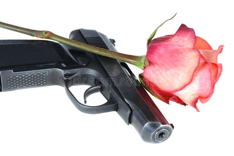 Gun and rose royalty free stock photo