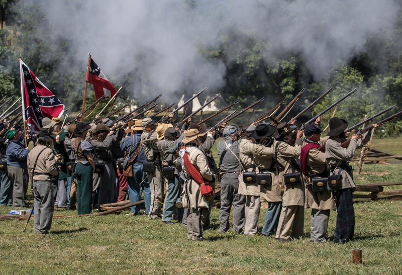 Gun Salute. Civil War era soldiers in battle at the Dog Island reenactment in Red Bluff, California stock photography