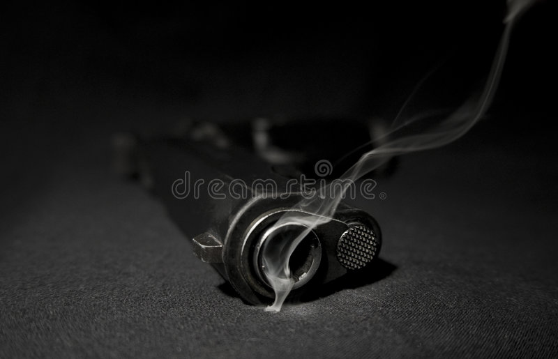 Gun and smoke stock image