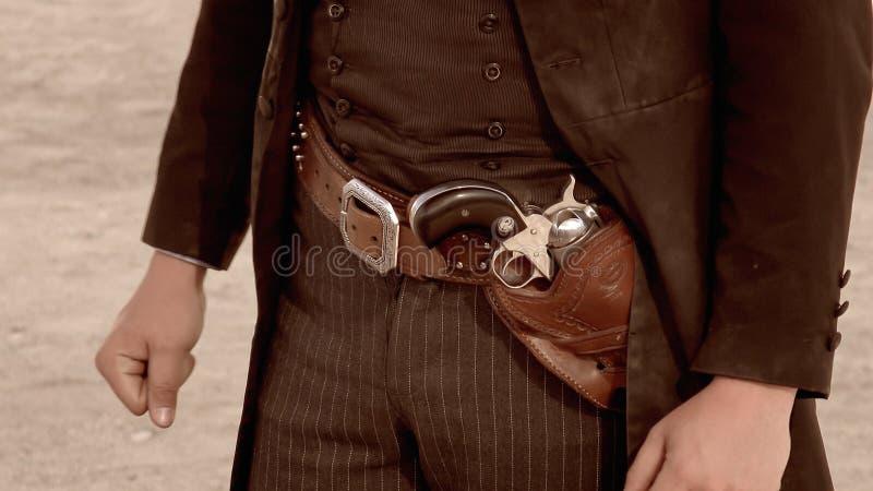 Gunbelt des Revolverheldes in der Finanzanzeige, Arizona lizenzfreies stockbild