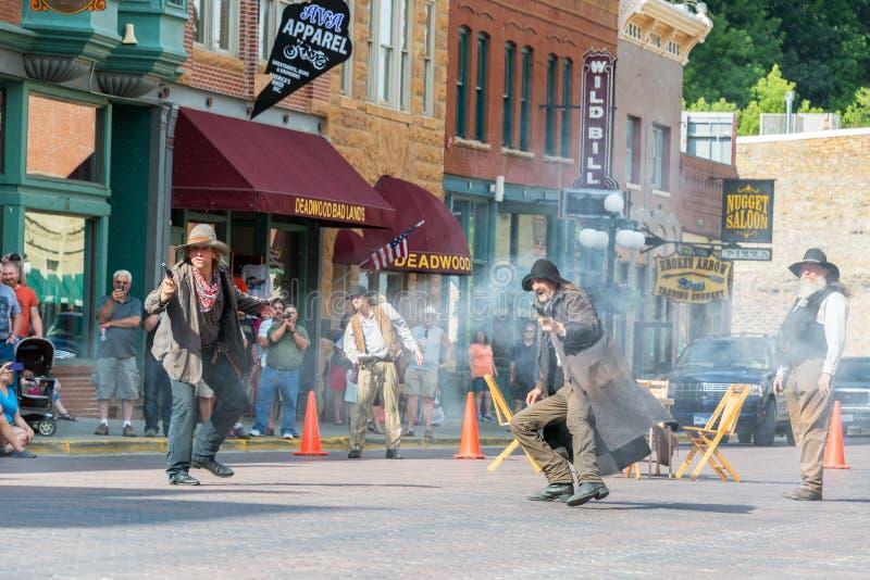 Gunfight Reenactment in Deadwood, South Dakota. DEADWOOD, SD - AUGUST 26: Actors reenact a historic gunfight in Deadwood, SD on August 26, 2015 stock images