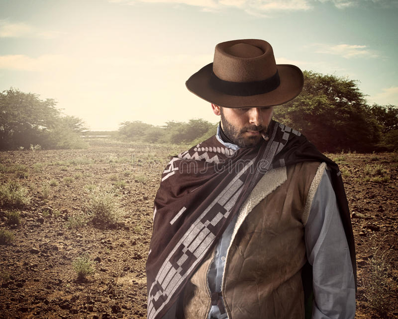 Gunfighter of the wild west. With serious and angry expression royalty free stock image