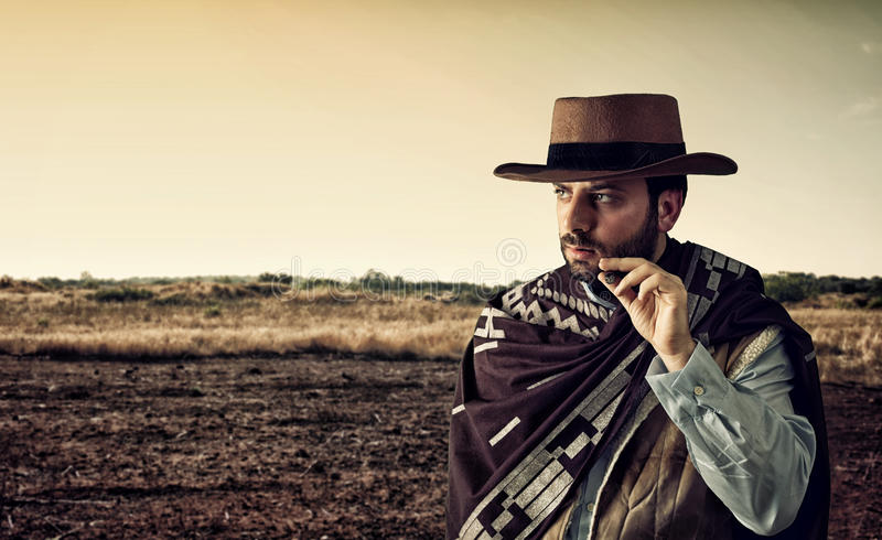Gunfighter of the wild west. With serious and angry expression stock photos
