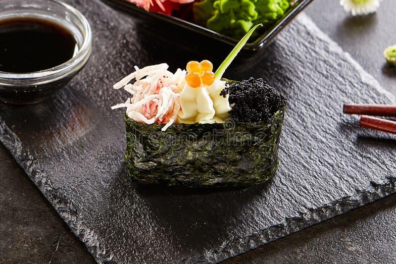 Gunkan with crab meat and masago caviar stock image