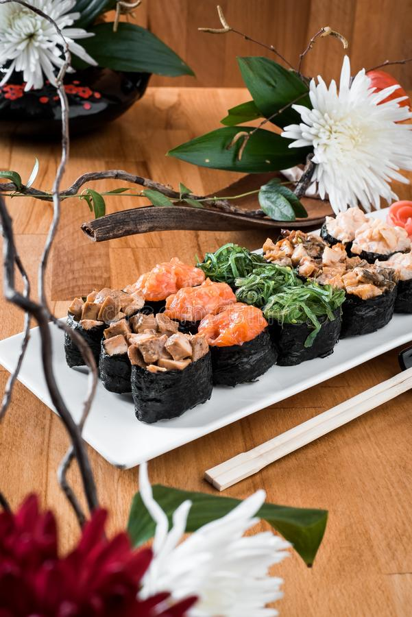 Gunkan sushi set with salmon, eel, chukka, shrimp and chicken meat on a white plate. Traditional Japanese cuisine. close up stock photos