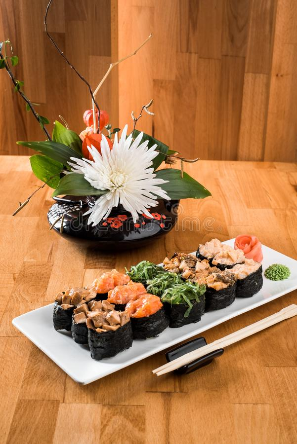 Gunkan sushi set with salmon, eel, chukka, shrimp and chicken meat on a white plate. Traditional Japanese cuisine. close up royalty free stock photography