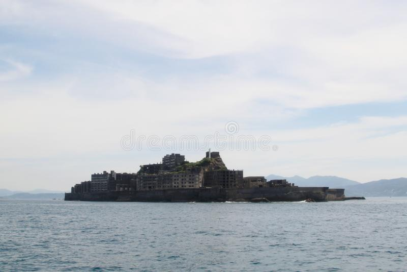 Gunkanjima, Slagschipeiland, Japan stock afbeelding