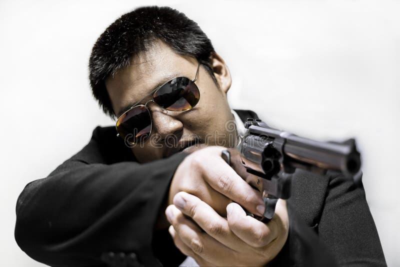 Hitman Gunman pointing out a gun for shooting. Gunman pointing out a gun for shooting stock image