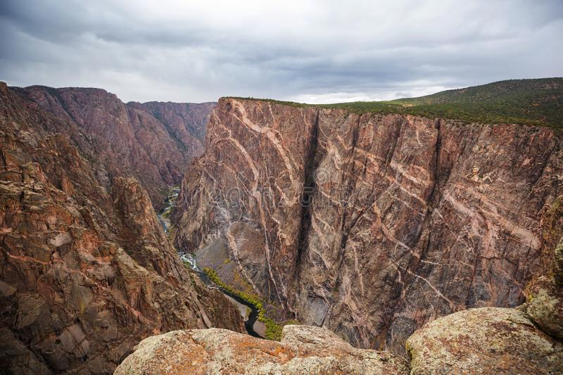 Gunnison. Tourist on the granite cliffs of the Black Canyon of the Gunnison, Colorado, USA stock images