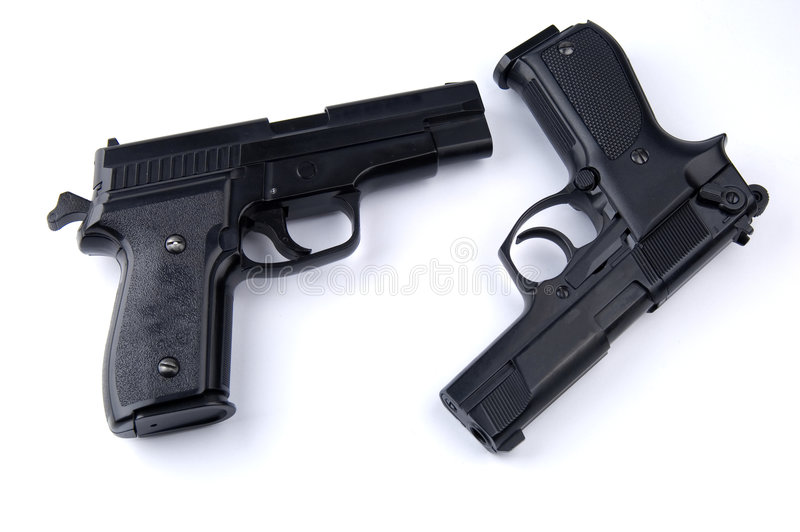 Guns. Photo of black guns on the white background royalty free stock photos