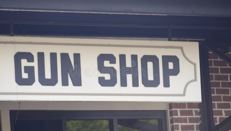 Guns, Ammunition and Firearms Shop. A Gun Shop where people can purchase pistols, shotguns, machine guns and AK47`s as well as ammunition and shotgun shells stock photos