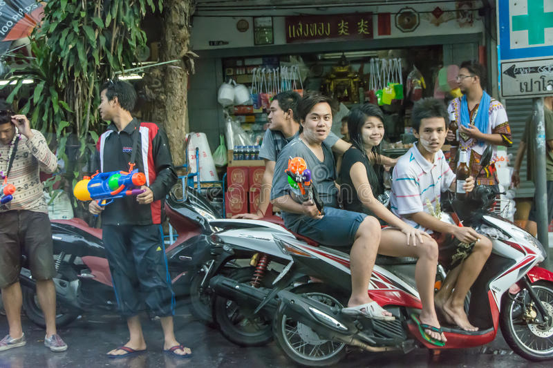 Guns and beers in Songkran, Thailand. BANGKOK, THAILAND - 12 APRIL 2013: Water guns, girls, and beers are the main objective of modern Songkran festival on stock photography