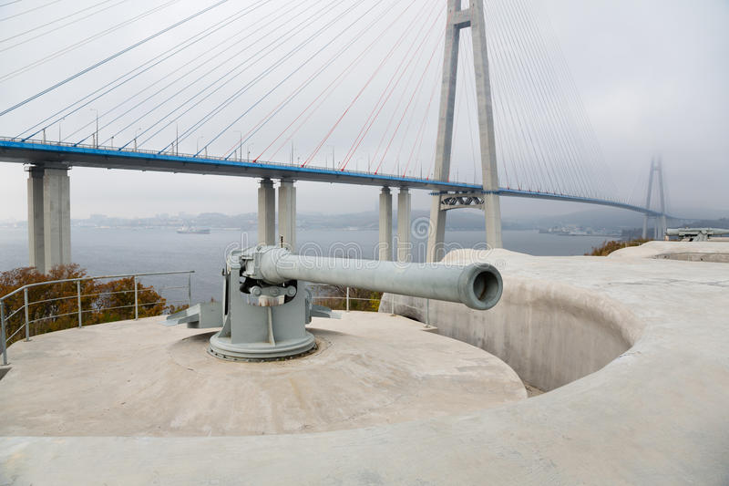 Guns coastal battery Vladivostok fortress. On the island of Russian and Cable-stayed bridge. Vladivostok, Russia royalty free stock photos