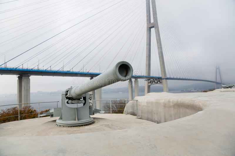 Guns coastal battery Vladivostok fortress, Russia. Guns coastal battery Vladivostok fortress on the island of Russian and Cable-stayed bridge. Vladivostok royalty free stock image