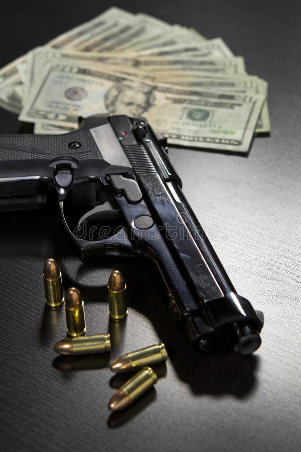Guns and money. Guns, bullets, and money on table stock photos