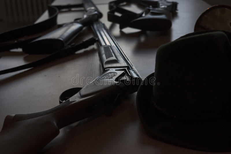 Guns at nigh detail on the table stock photos
