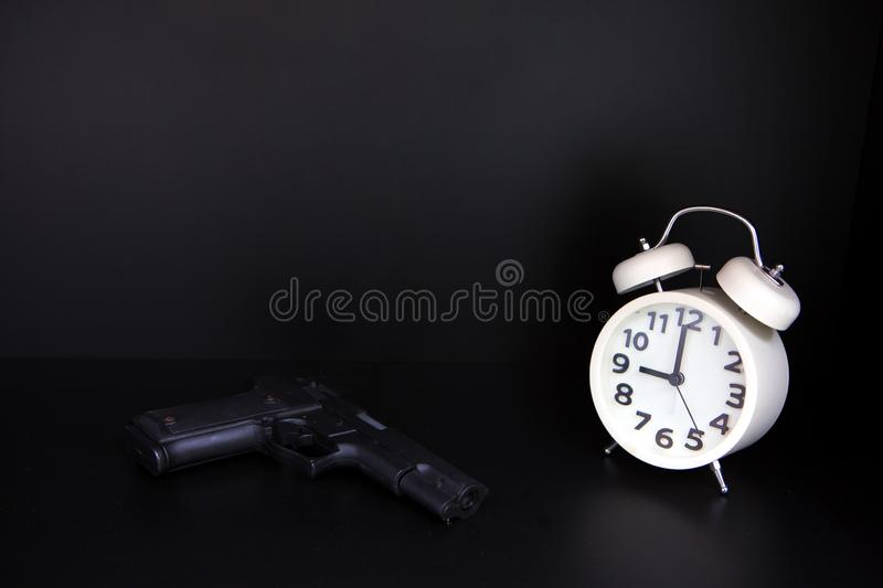 Guns and watches. The time of the businessmen is running out stock photography