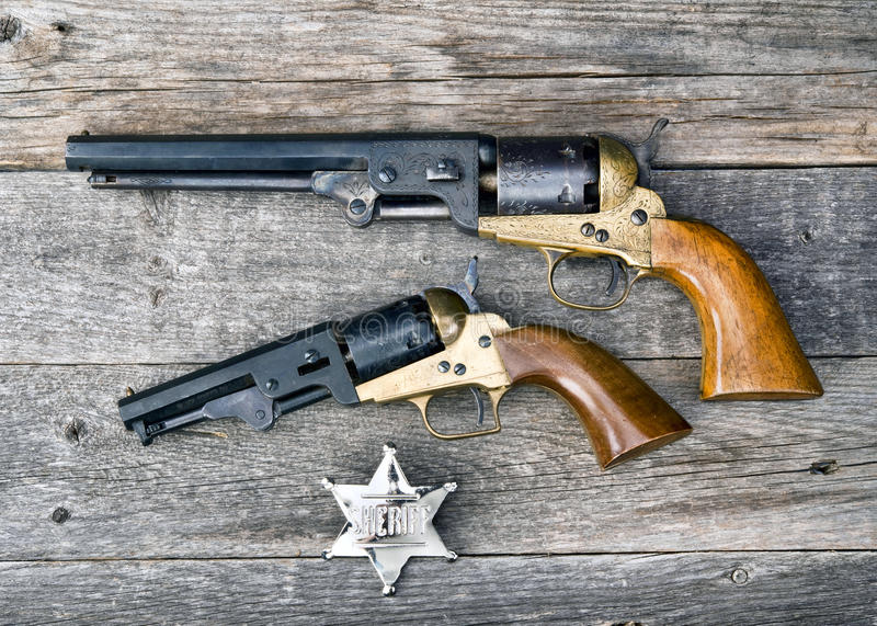 The guns that won the west. The guns that won the west and silver sheriff badge stock image