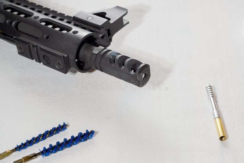 Gunsmith cleaning gun rifle assemble maintenance. White background. Gunsmith cleaning gun rifle assemble maintenance stock photography