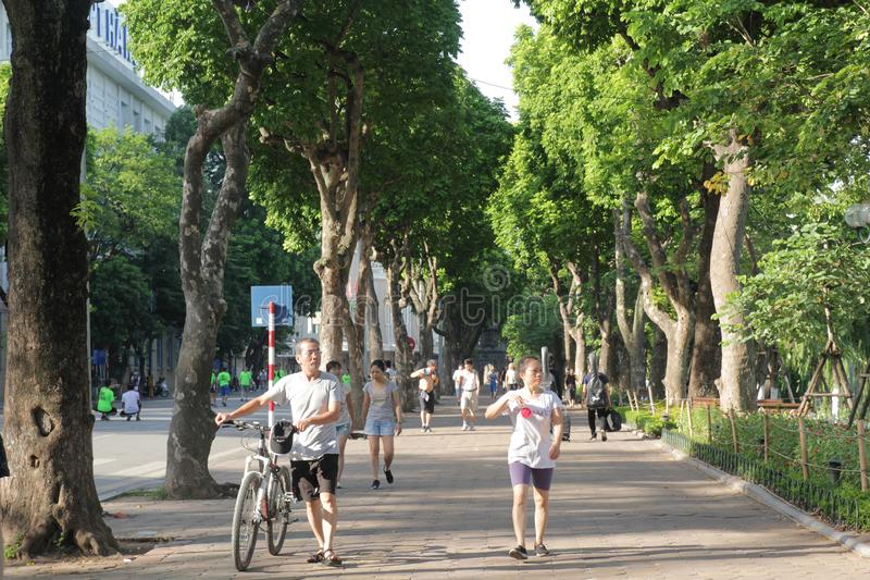 Guom lake, Hanoi, Viet Nam - July 05,2019: People is doing exercise to improve health in the morning royalty free stock photography